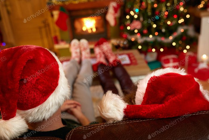Couple with Santa Claus hats