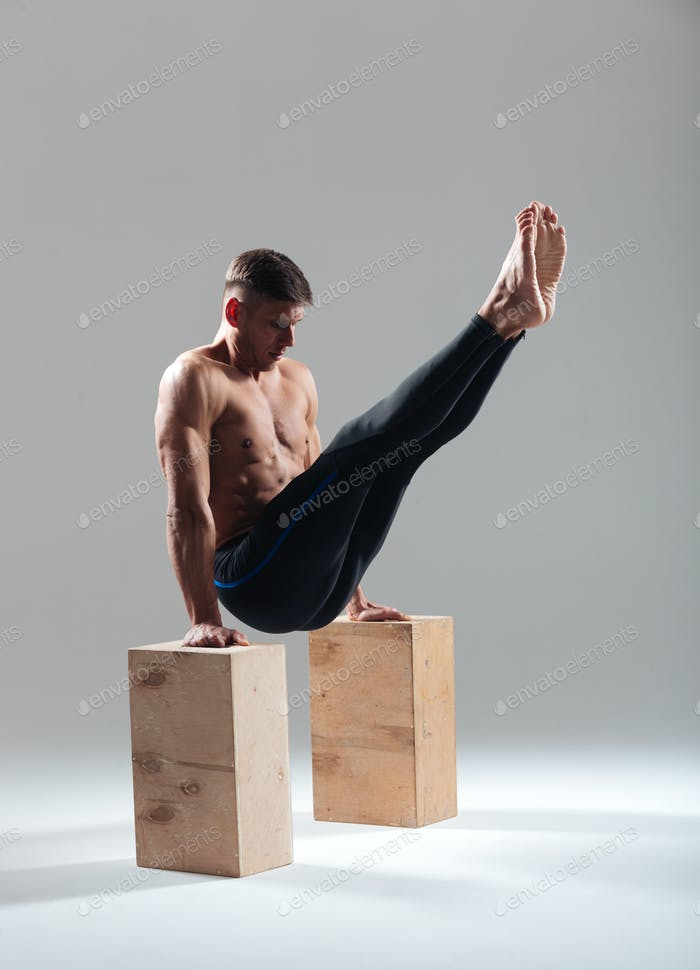 Fitness man workout on wooden box