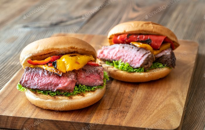 Burgers with grilled steak and bell peppers