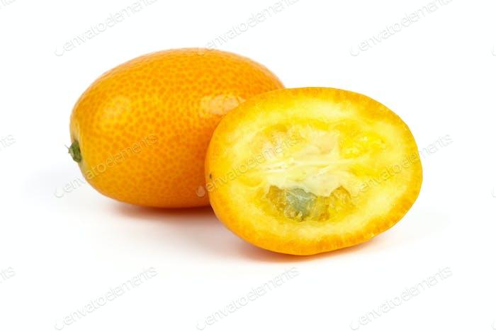 Whole and sliced kumquat fruits