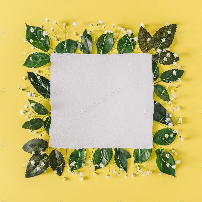Layout with flowers and leaves. Summer frame background. Flat lay social mockup with copy space.