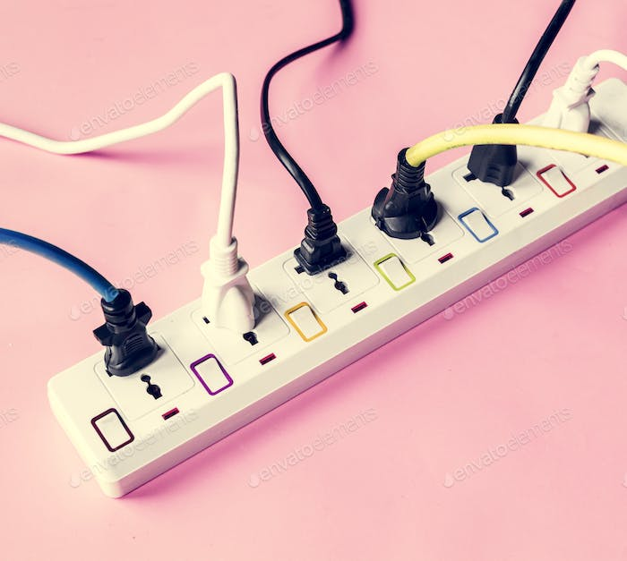 Fulled electrics power supply plug on pink background