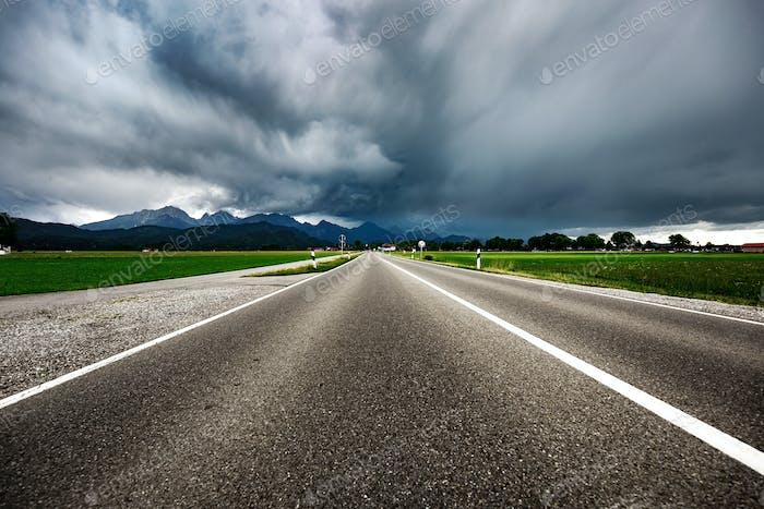 Road leading into a storm - Forggensee and Schwangau, Germany Ba