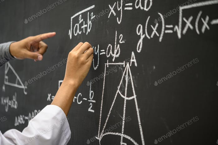 The hand that is written with the white chalk and the hand that shows the formula on the blackboard.