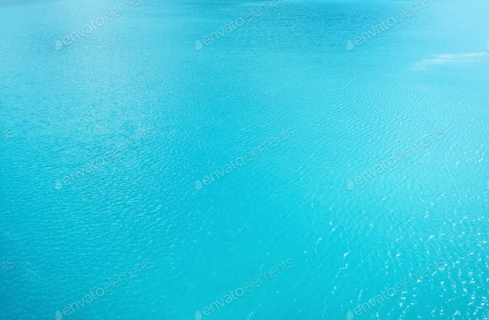 Water on the lake as a background. Turquoise color