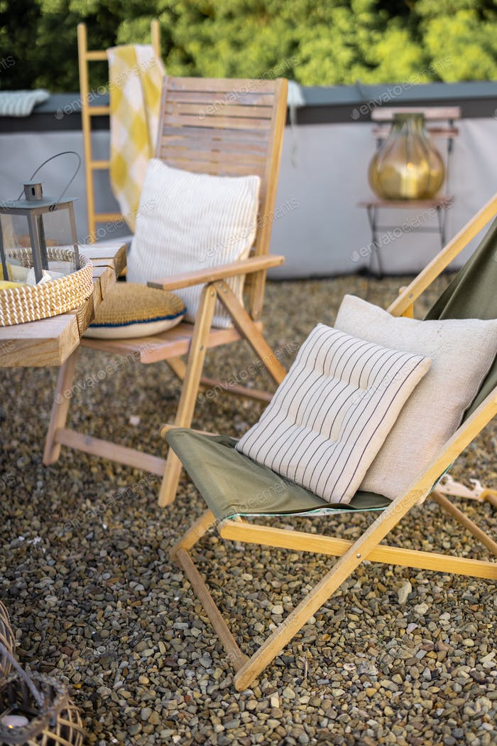 Beautiful wooden chairs on a rooftop