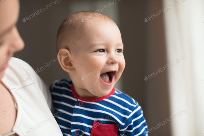 Happy smiling baby boy, close-up portrait