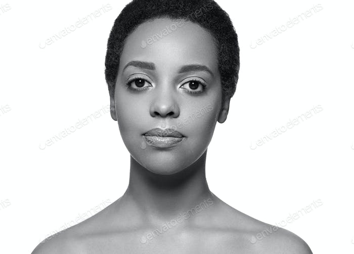 Black skin beauty woman pure natural skin afro girl isolated on white. Monochrome. Black. Gray.