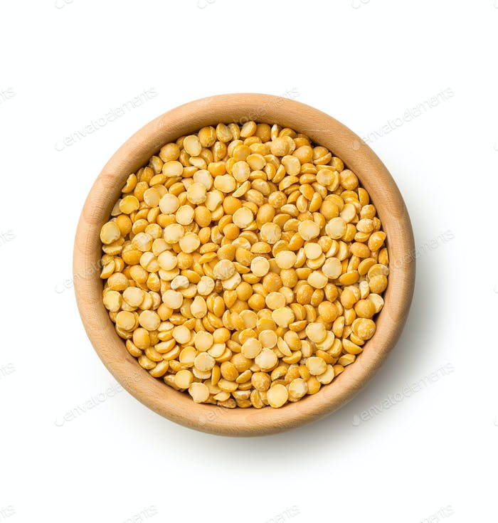Yellow split peas in wooden bowl.