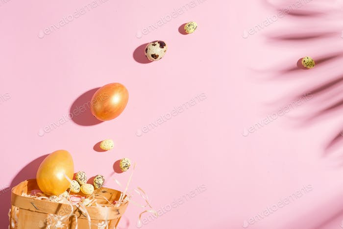 Easter holiday card with shadows from tropical palm leaves, golden painted chicken and quail eggs on