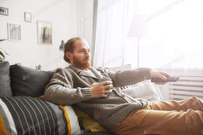 Man Relaxing at Home with TV