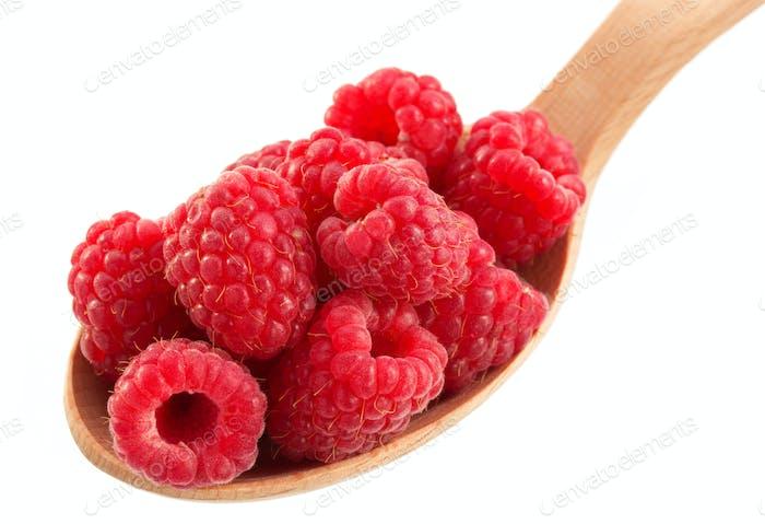 raspberry in spoon on white