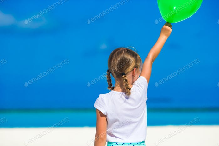 Adorable little girl with balloon outdoor