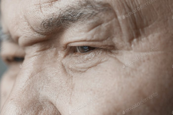 Face of elderly man looking away