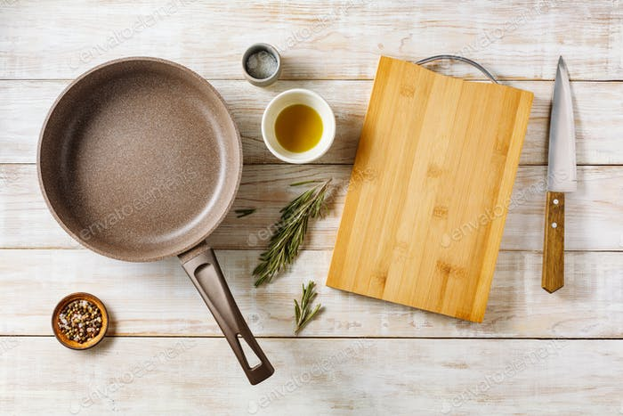 Empty frying pan with cutting board