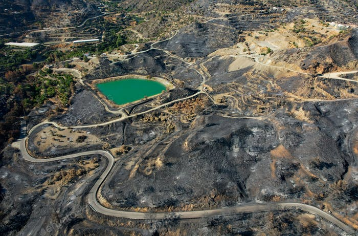 Mountain fire with burned agriculture land and forest. Disaster of the environment Cyprus