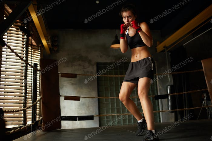 Tough Female Fighter in Boxing Ring