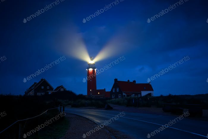 lighthouse lightbeams in night