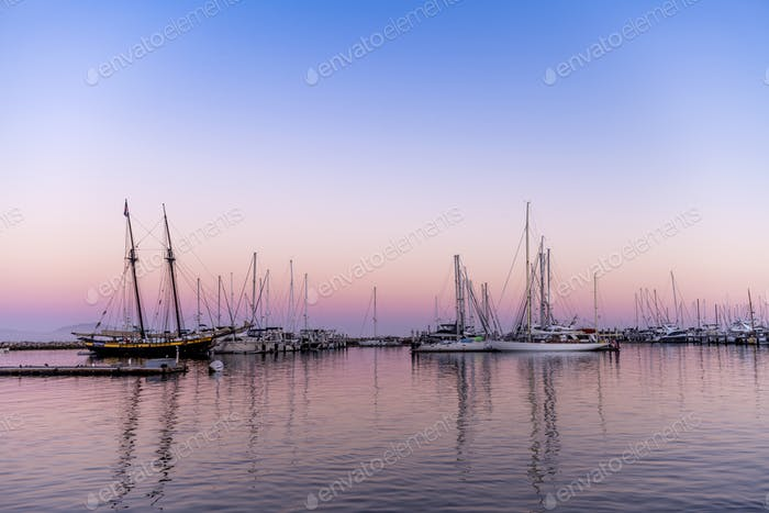 Sailboats in bay at sunset
