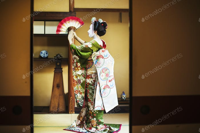 Geisha in costume with fan