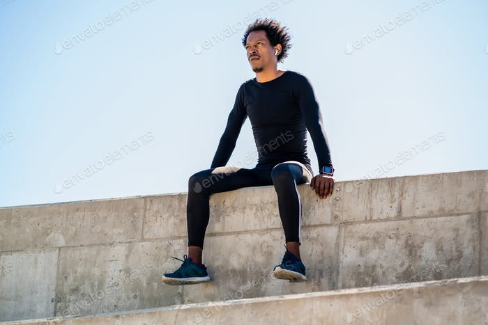 Athletic man relaxing after work out outdoors.
