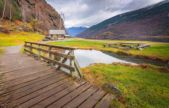 Small wooden bridge on a path leading to the fjord shore