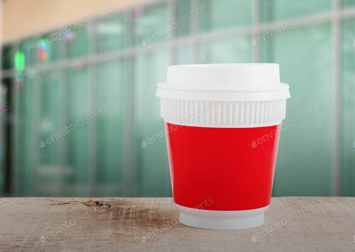 Plastic cup with office background