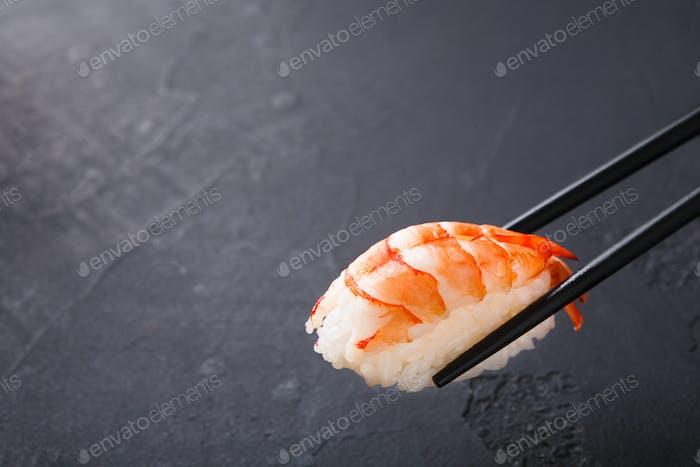 Eating sushi at restaurant, japanese cuisine