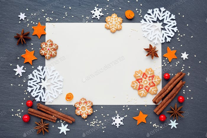 Christmas background with gingerbread cookies, snowflakes, spice