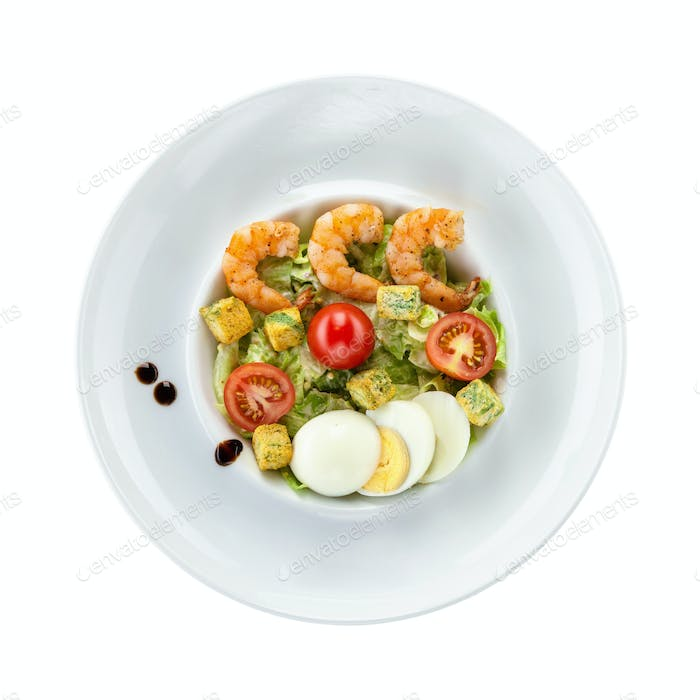 Caesar salad with shrimps over white. With path.