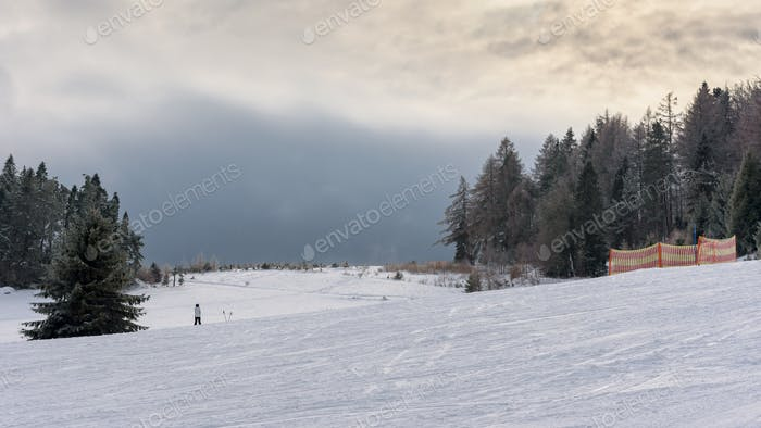 Dark clouds over ski slope in Beski Sadecki mountains
