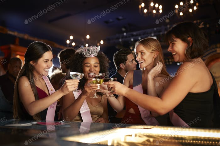 Group Of Female Friends Celebrating With Bride On Hen Party In Bar