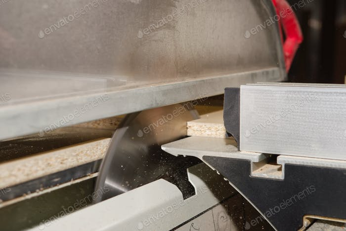 Male carpenter uses a circular saw for wood in the manufacture of closeup