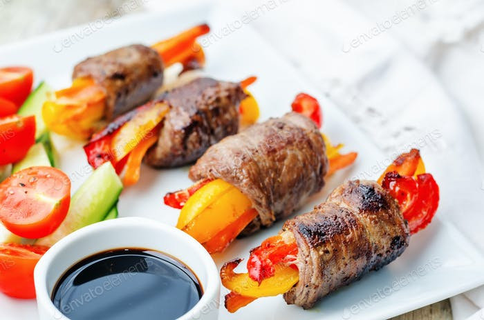 beef stuffed peppers, carrots and onions with balsamic dressing