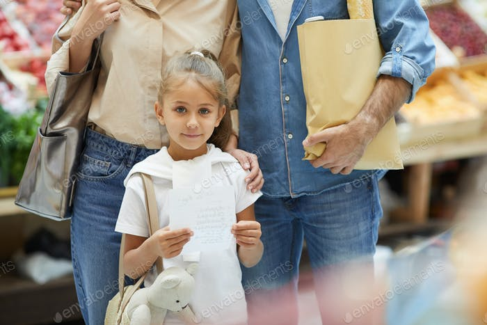 Little Girl with Parents in Supermarket