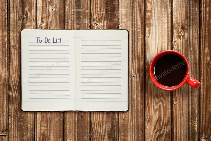 To do list on diary and coffee cup on wooden table