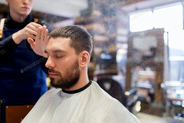 Thumbnail for barber applying styling spray to male hair