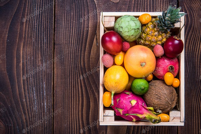 Wooden box with exotic fruits