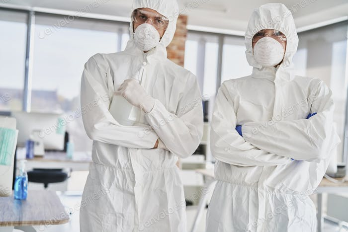 Portrait of two technicians in protective workwear ready to work
