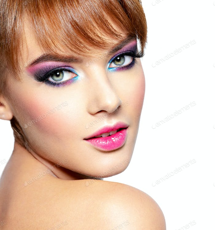 Beautiful woman with bright vivid purple make-up.