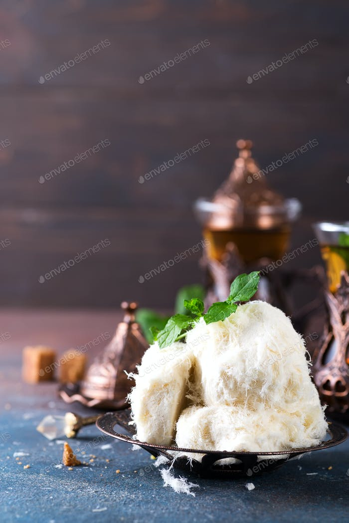 Traditional Turkish cotton candy called Pismaniye in vintage plate with tea on stone