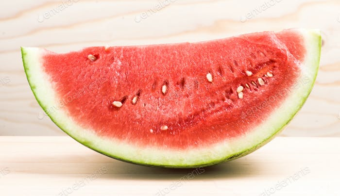 half watermelon on light wood