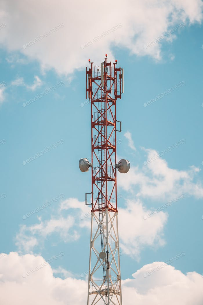 Telecommunications Cell Phone Tower With Antenna On Sunny Sky