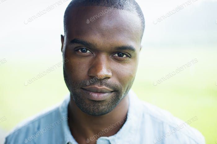 A young man in a blue shirt.
