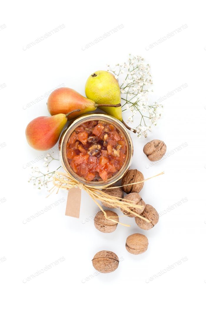 Pear jam in a glass jar on a white background top view.