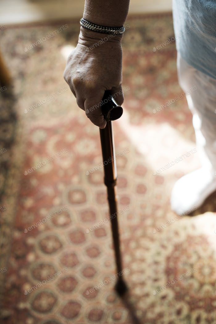 Senior woman using a cane