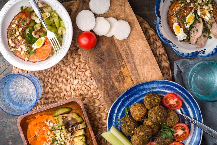 Vegetable salads, falafel on the table