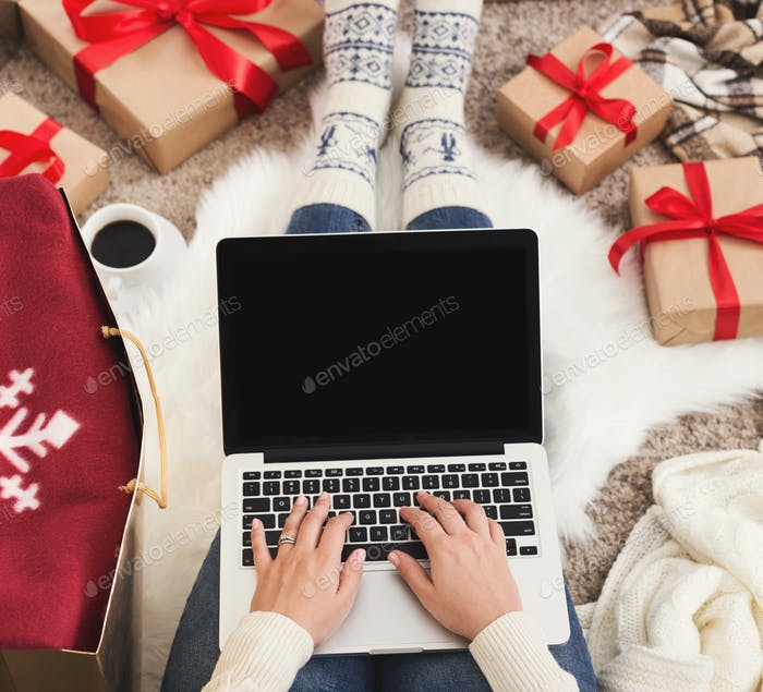Christmas sales. Woman shopping on market website