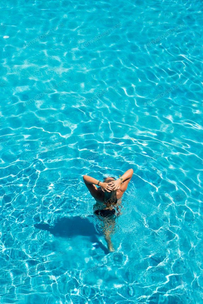 woman in bikini at the swimming pool