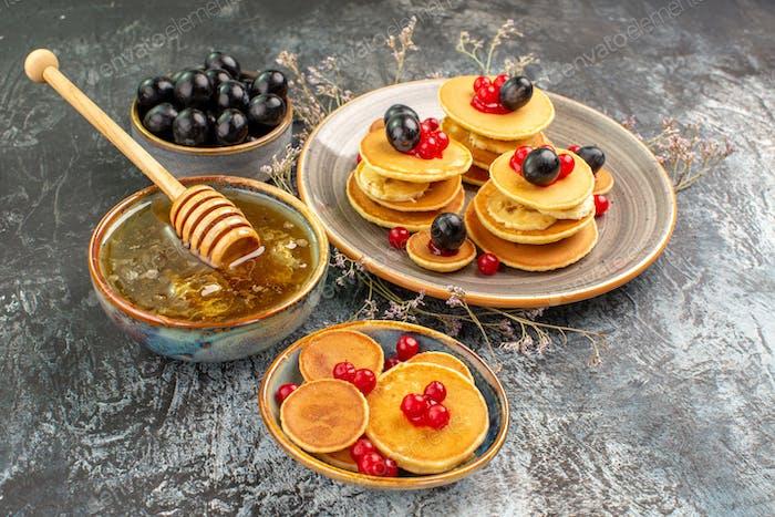 Top view of American pancake honey balck cherry on gray background
